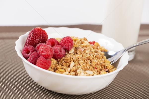 Stock photo: Berries on golden cereals in bowl