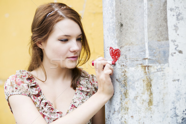 Woman in dress draw heart on wall Stock photo © vetdoctor