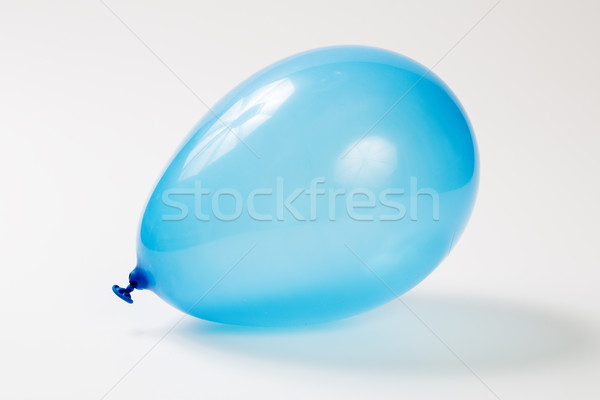 Blue balloon with helium on studio ground Stock photo © vetdoctor