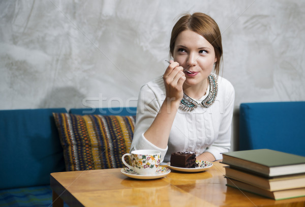 Woman eat cake with pleasure  at cafe Stock photo © vetdoctor