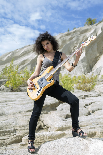 Woman play yellow bass guitar on background Stock photo © vetdoctor