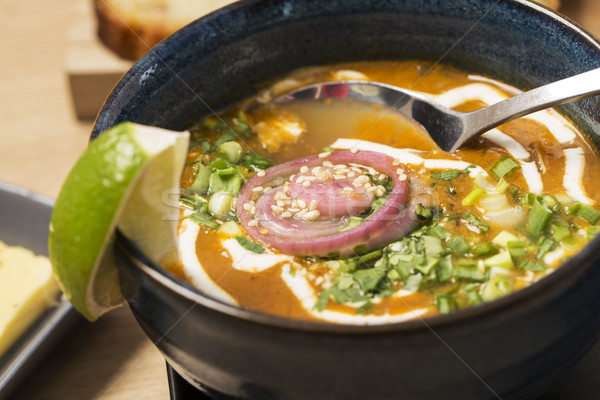 Zoomed bowl with soup and spoon Stock photo © vetdoctor