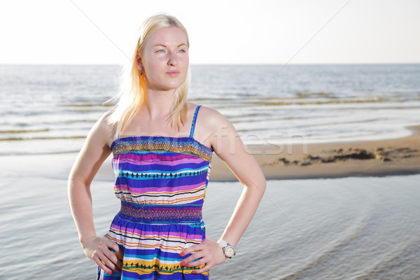 Woman in lined dress on sea shore Stock photo © vetdoctor
