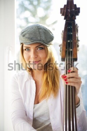 Woman with hat and part of contrabas Stock photo © vetdoctor