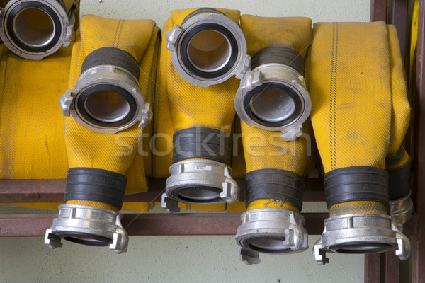 Zoomed yellow firehose are hanging in warehouse Stock photo © vetdoctor