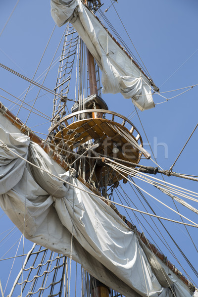 Mast with collected sails at windy day Stock photo © vetdoctor