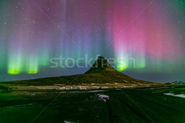 Settentrionale luci aurora Islanda acqua montagna Foto d'archivio © vichie81