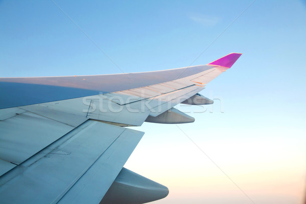 Sunrise with Airplanes wing Stock photo © vichie81