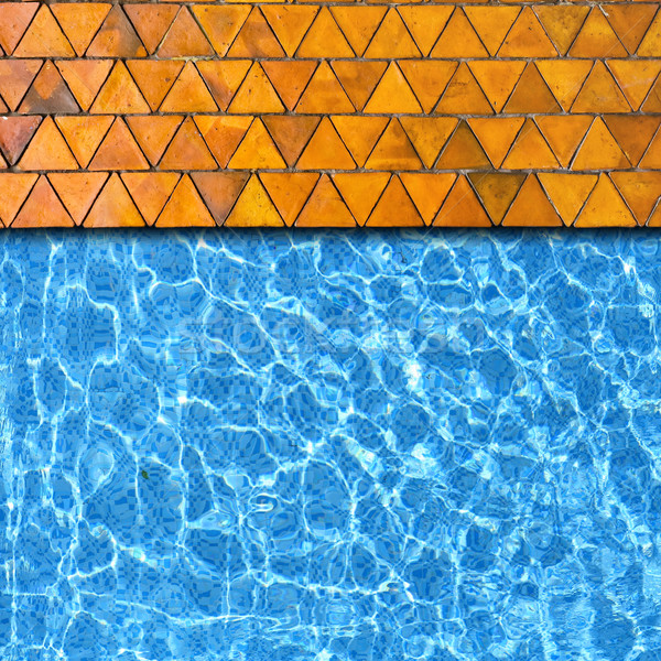 triangle stone pavement with pool edge background Stock photo © vichie81
