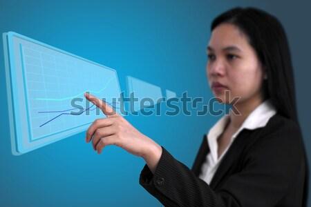 Up tendance graphique asian femme d'affaires touch Photo stock © vichie81