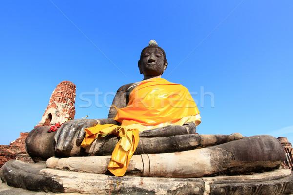 black buddha statue over blue sky Stock photo © vichie81