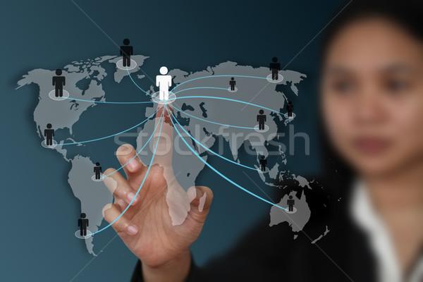 Mundo red social femenino mano pantalla táctil mapa Foto stock © vichie81