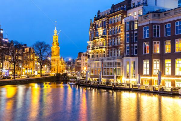 Amsterdam Holanda torre praça crepúsculo água Foto stock © vichie81