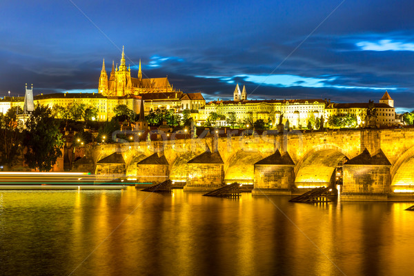 Pargue at dusk, view of the Lesser Bridge Tower of Charles Bridge (Karluv Most) and Prague Castle, C Stock photo © vichie81