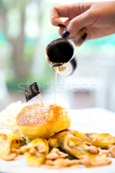 Pancake miele sciroppo cocco alimentare mano Foto d'archivio © vichie81