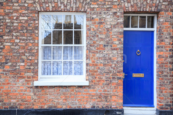 Gótikus stílus ház ablakok ajtó tégla Stock fotó © vichie81