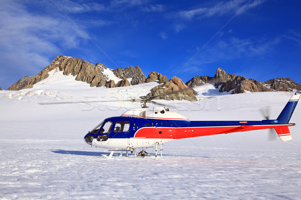 Helicopter landing on top of Franz Josef Glacier in New Zealand. Stock photo © vichie81