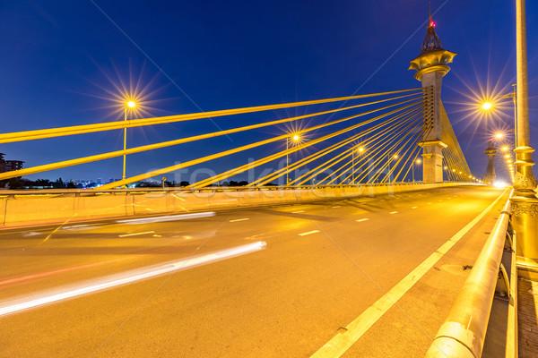 Puente puesta de sol agua edificio ciudad luz Foto stock © vichie81