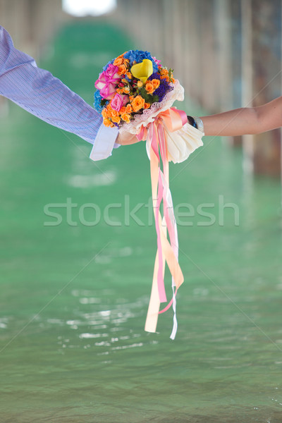 two hand holding beautiful flower bouquet, vertical Stock photo © vichie81