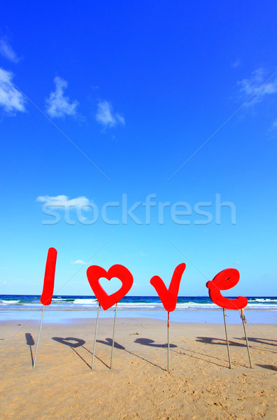 Love sign on the beach Stock photo © vichie81
