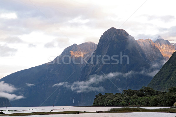 Sun rise high mountain glacier at milford sound, New Zealand Stock photo © vichie81
