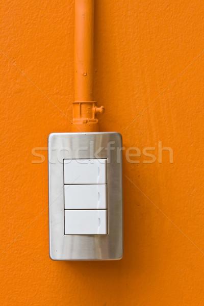 Interrupteur de lumière orange mur maison lampe énergie Photo stock © vichie81