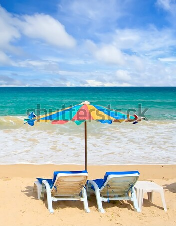 Couple chair and multi-color umbrella on the beach with perfectl Stock photo © vichie81