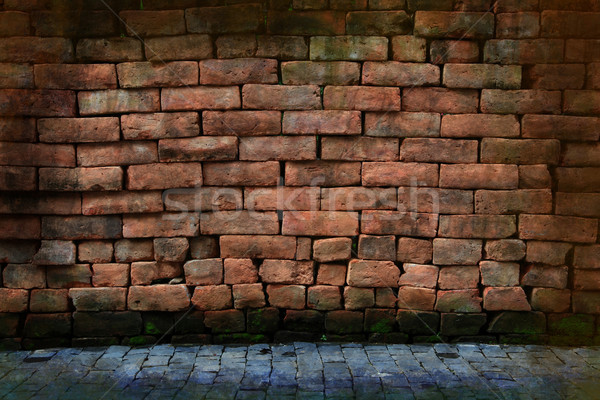dirty grunge red stone brick wall with pavement Stock photo © vichie81