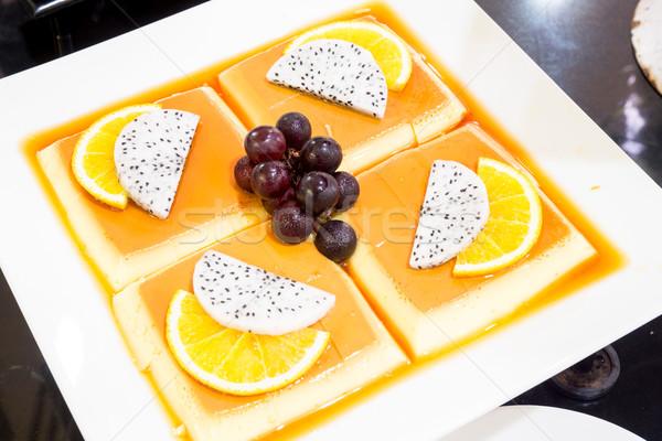 プリン カスタード トロピカルフルーツ フルーツ 背景 オレンジ ストックフォト © vichie81