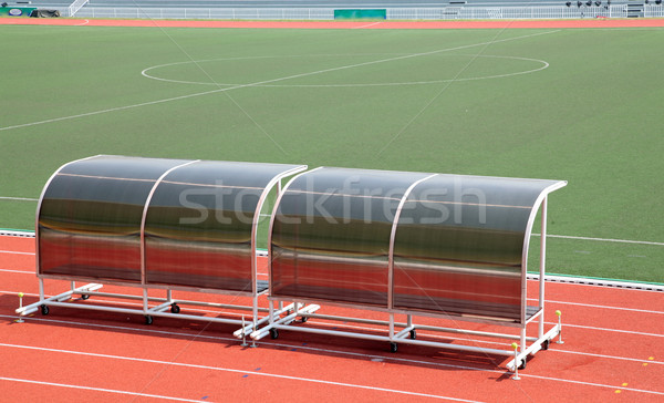 Coach and reserve benches in football stadium Stock photo © vichie81