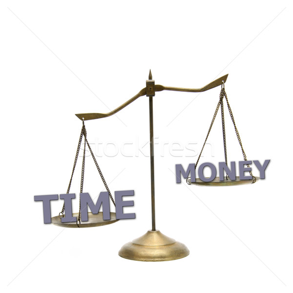 time is greater money concept on golden brass scales Stock photo © vichie81