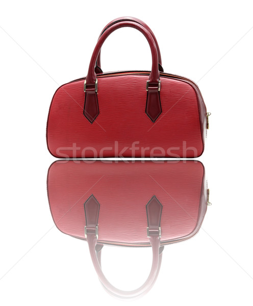 red fake leather woman bag with its reflection Stock photo © vichie81