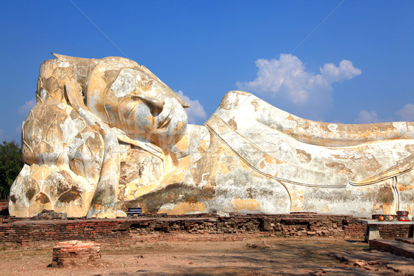 giant reclining buddha statue over blue sky Stock photo © vichie81