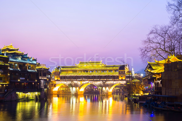 Brug China phoenix oude stad zonsondergang Stockfoto © vichie81
