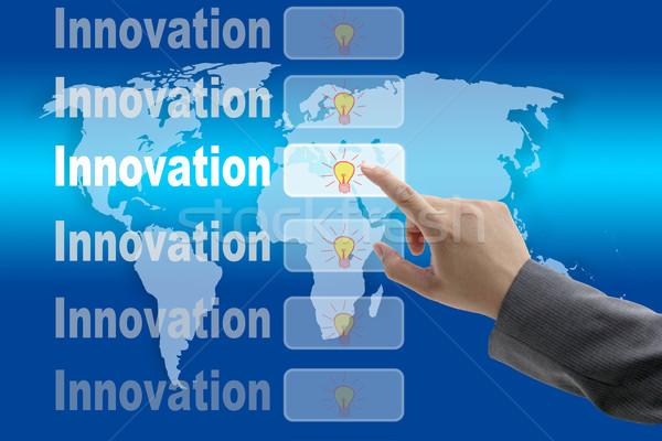 Mundo inovação masculino negócio mão empurrando Foto stock © vichie81