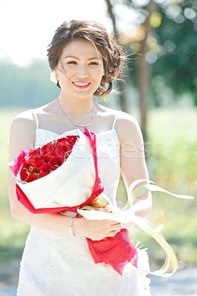 beautiful bride outdoors with rose bouquet Stock photo © vichie81