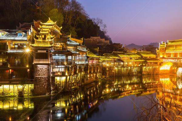 Oude stad China phoenix zonsondergang huis Stockfoto © vichie81