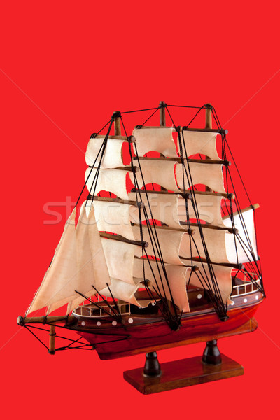 isolated model of luxury sailboat on red background Stock photo © vichie81