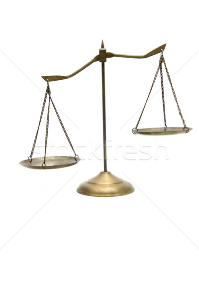 unbalance of golden brass scales of justice on white Stock photo © vichie81