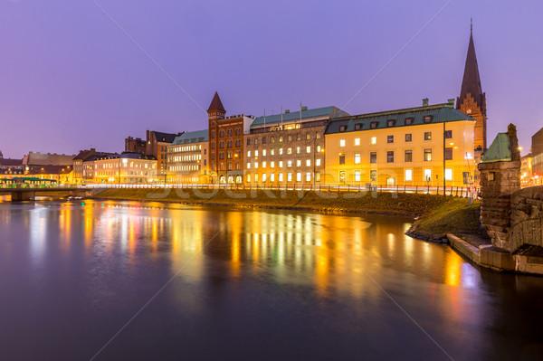 Városkép belváros éjszaka szürkület víz város Stock fotó © vichie81