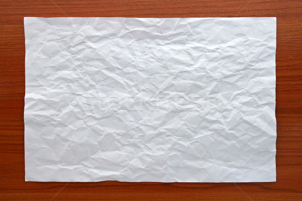 Stock photo: Wrinkled White paper attach on Wooden Board
