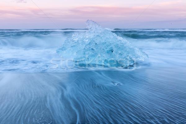 Iceberg spiaggia Islanda ghiacciaio sunrise tramonto Foto d'archivio © vichie81