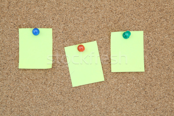 three yellow memo sticker on notice cork board Stock photo © vichie81
