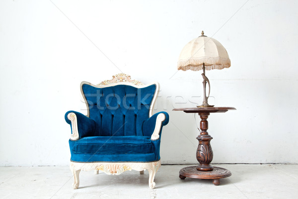 Armchair with desk lamp in vintage room Stock photo © vichie81