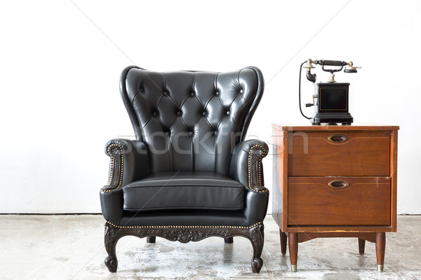 Retro leather chair with telephone Stock photo © vichie81