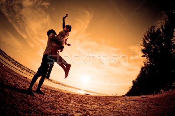Romantica scena coppie spiaggia wedding tramonto Foto d'archivio © vichie81