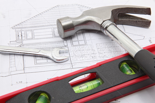 construction tools with house blueprint Stock photo © vichie81