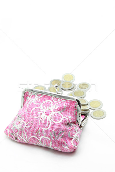 coins spilling out from flower pink money bag or purse isolated Stock photo © vichie81