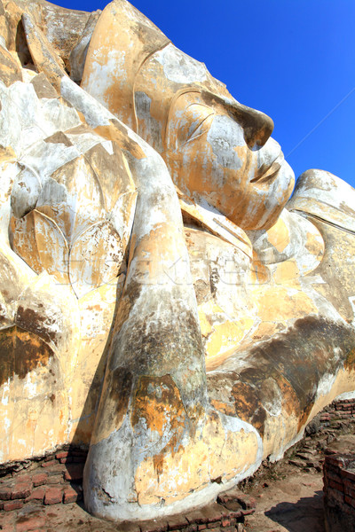 giant reclining buddha face statue over blue sky Stock photo © vichie81