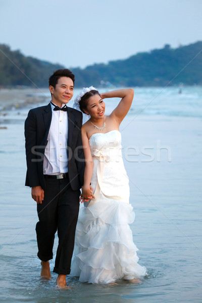 newlywed couples walking Beach Stock photo © vichie81